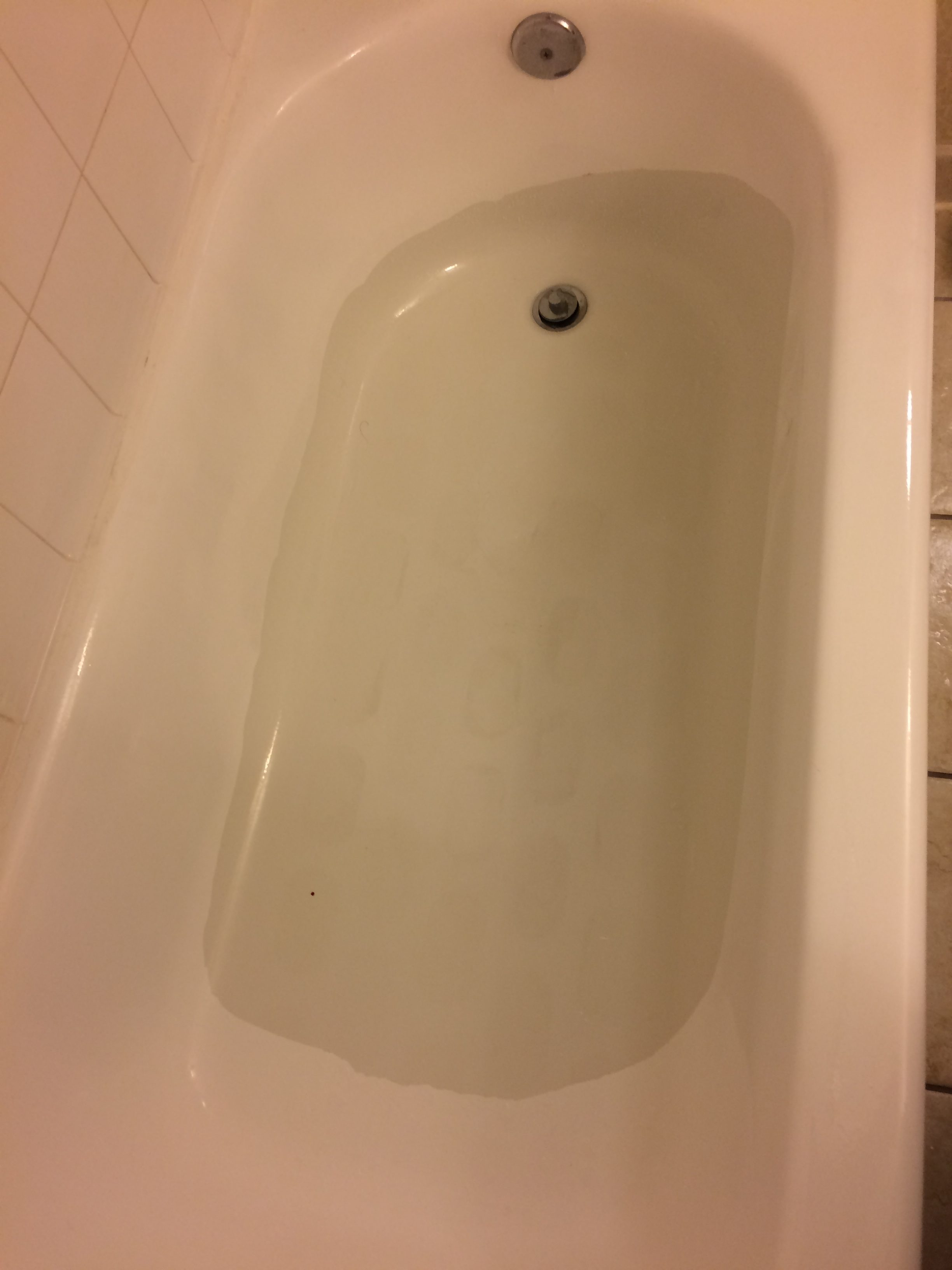 tub with strange coating - Hilton before