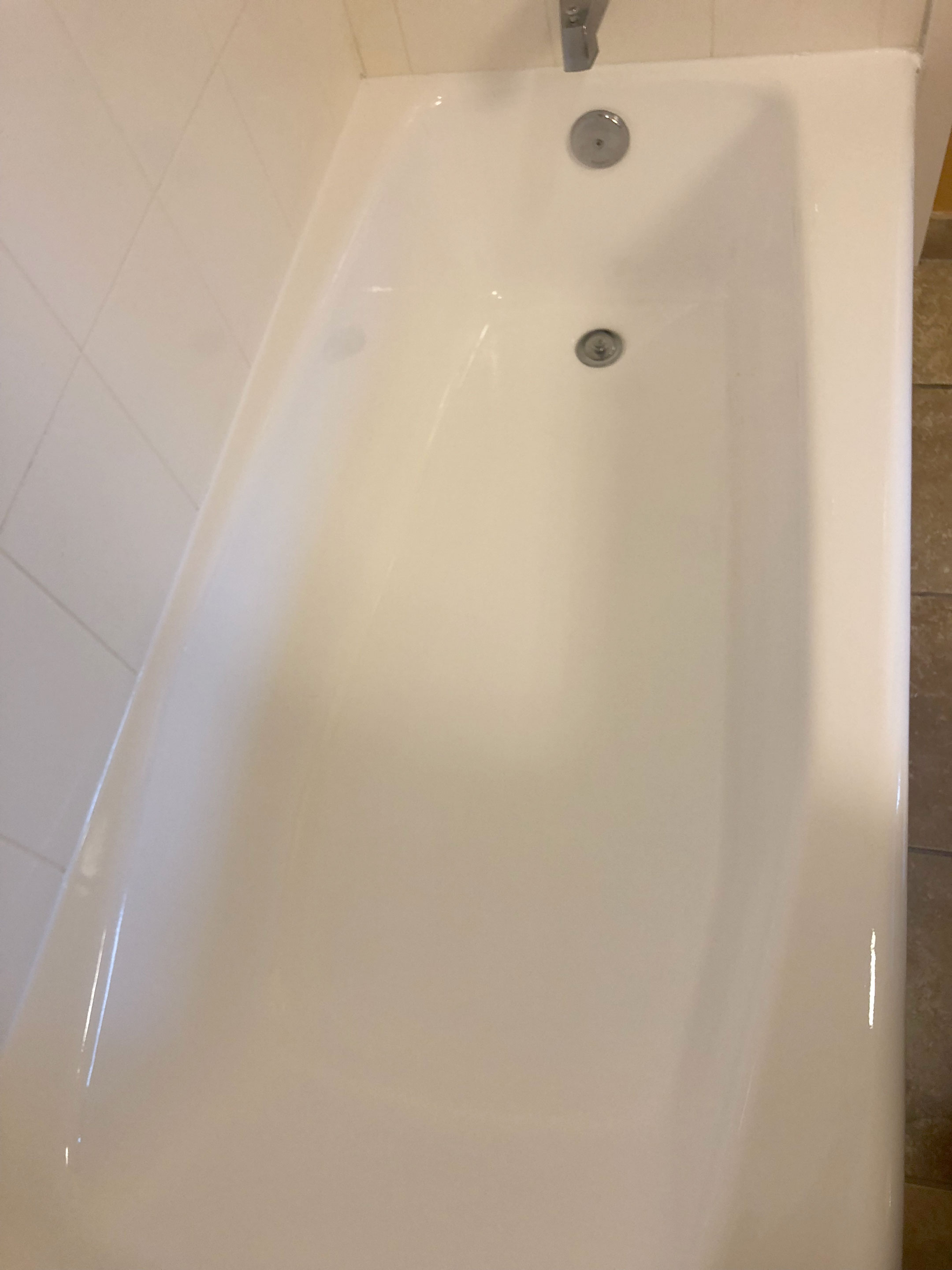 Chipped and peeling tub after