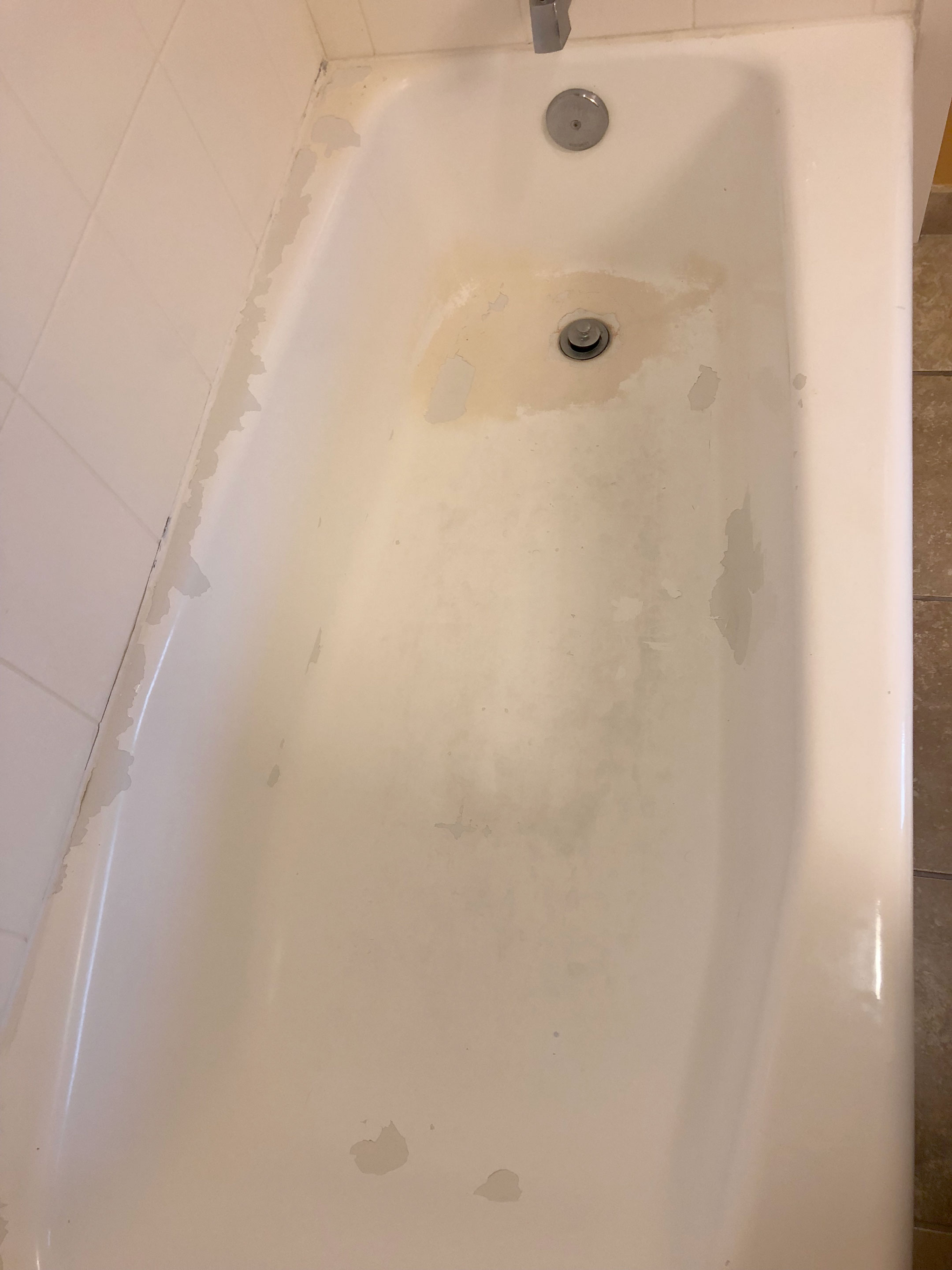 Chipped and peeling tub before